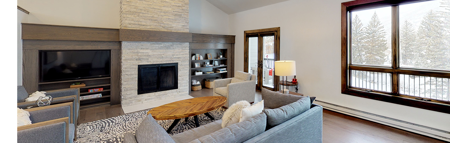 Coldstream Condo Living Room With Fireplace