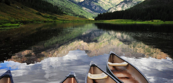 Canoes On Water In Summer