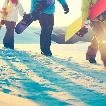 Snowboarders Walking