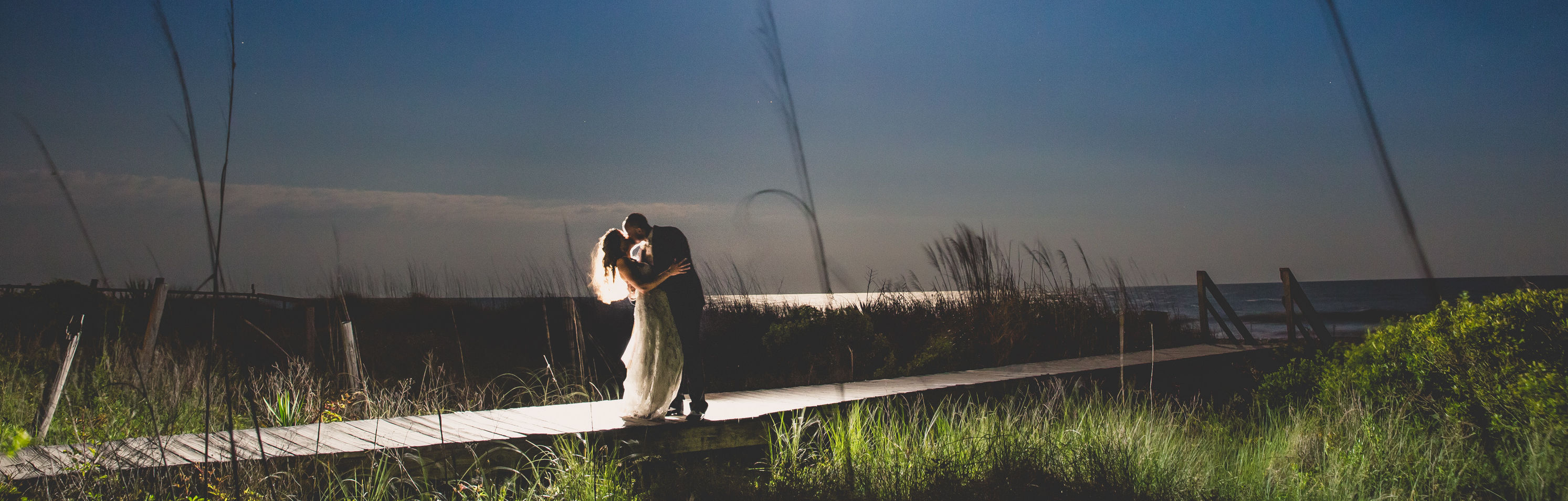 Wild Dunes_Weddings_Couples_NightBoardwalk
