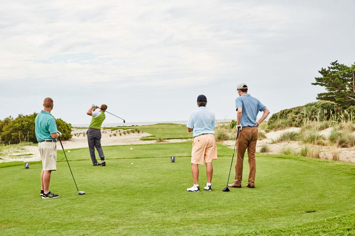 foursome playing golf