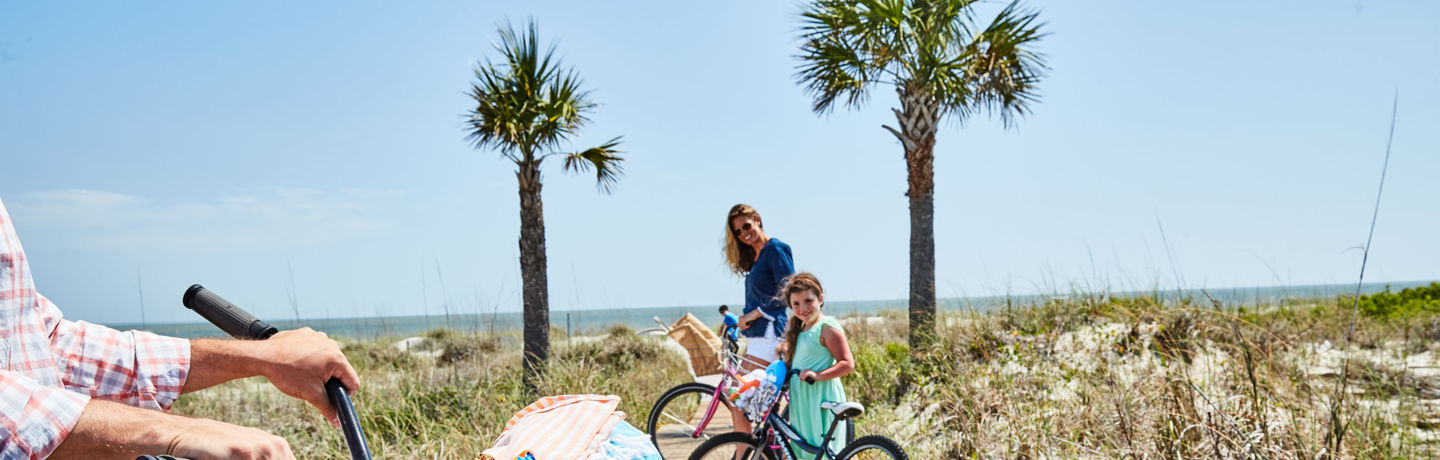 Family with bikes and activities on boardwalk