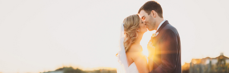 Wild Dunes_Weddings_Couples_BeachKiss