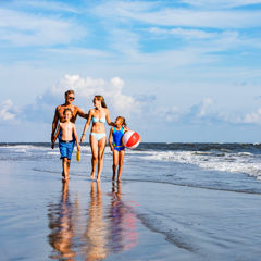 Family time on the beach at Wild Dunes Resort