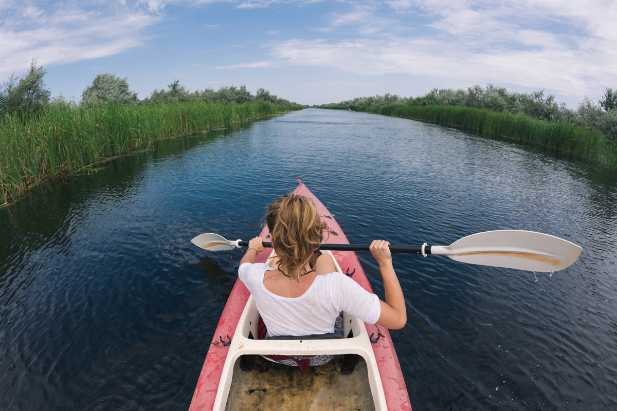 Destination discovery: girl on a kayaking adventure
