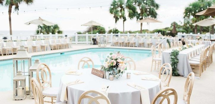 Grand Pavilion Poolside Reception with rented chairs and cafe lighting