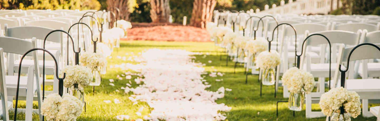Wild Dunes_Weddings_Venues_CroquetLawn_Aisle