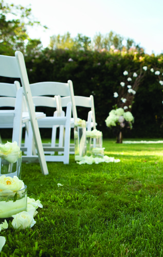 White Wedding Chairs on Lawn