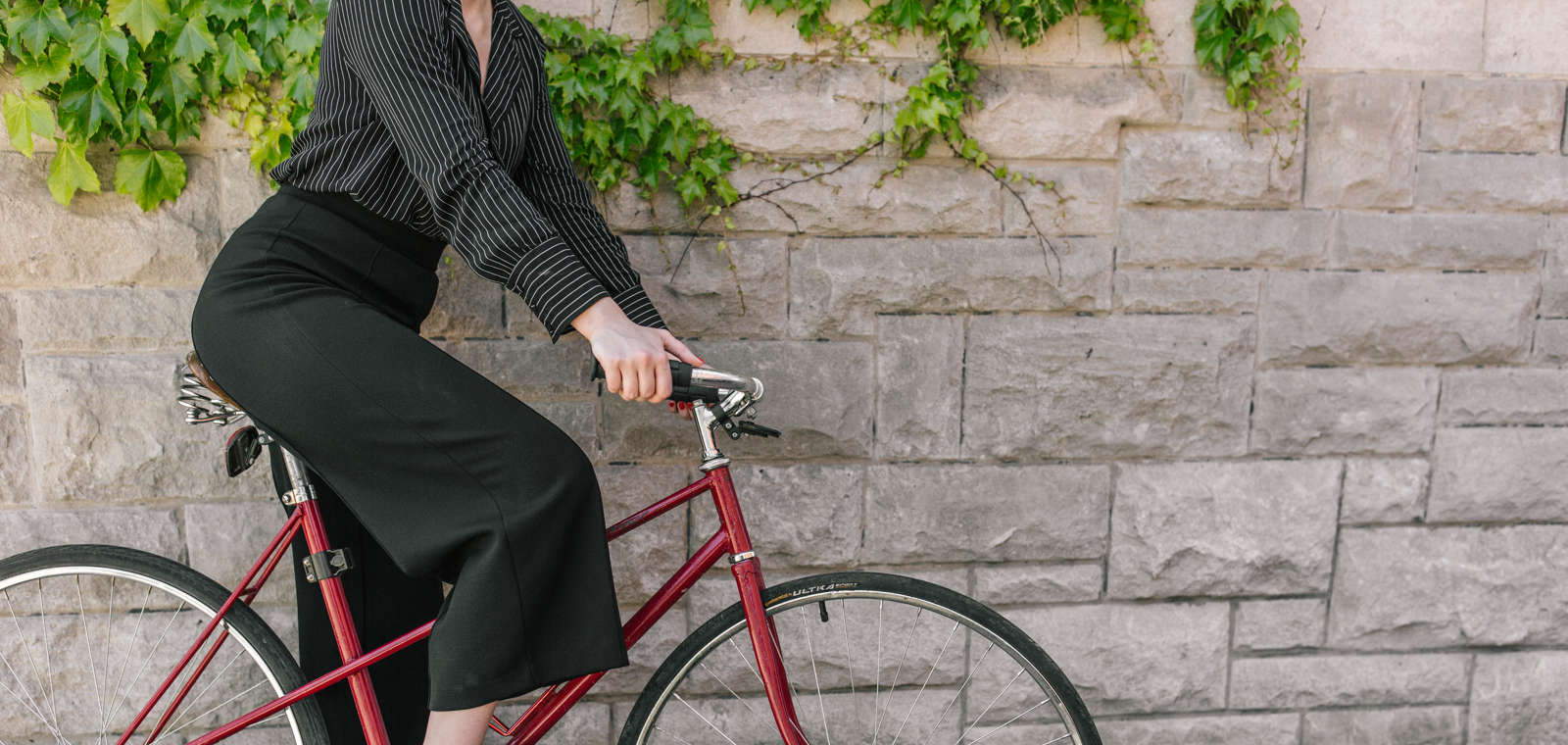 Woman on Bike by Hotel, shot by photographer Wesley Taylor