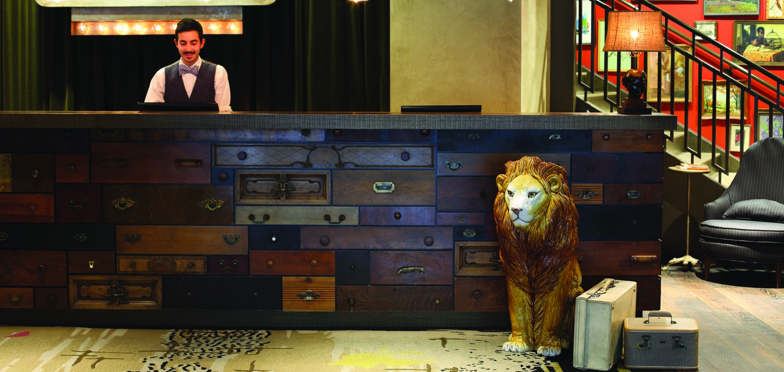 Hotel Lincoln Reception Desk with a Lion Statue