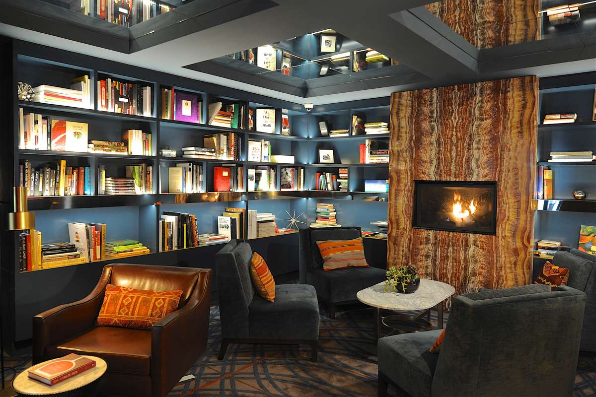 Hotel Library With Sitting Area And Fireplace