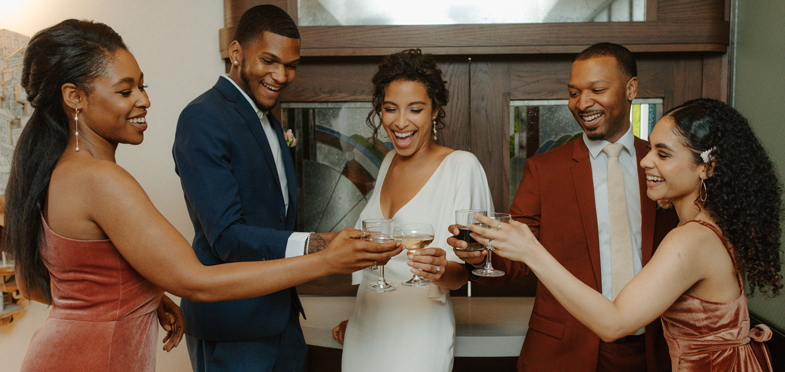 Bride and Groom Toasting with Wedding Party