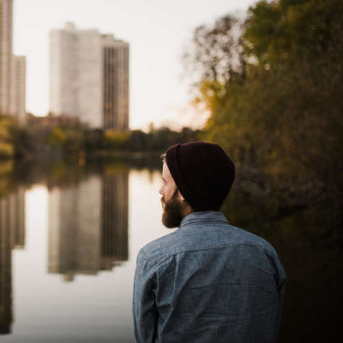 Man gazing at river.