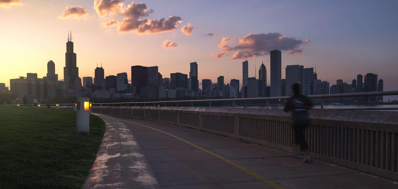 A long runner passes the skyline