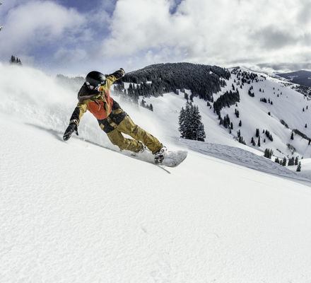 <b>Snowboarder in powder in the back bowls at Vail, CO.</b>