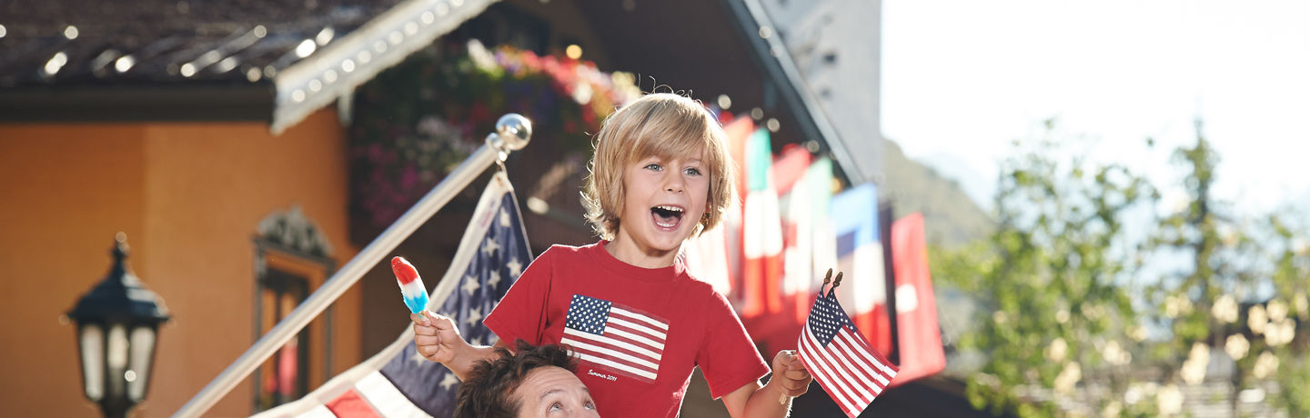<b>A father and son enjoy 4th of July in Village in Vail, CO.</b>