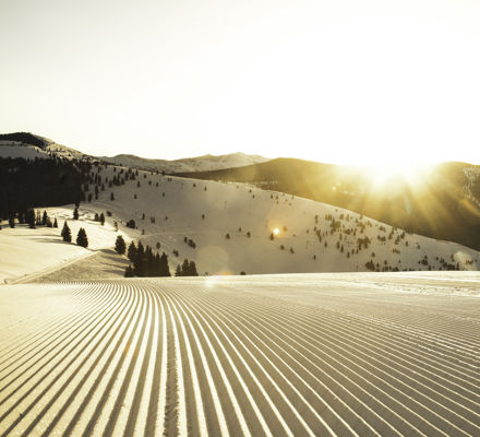 <b>Freshly groomed trail at sunrise in Vail, CO.</b>