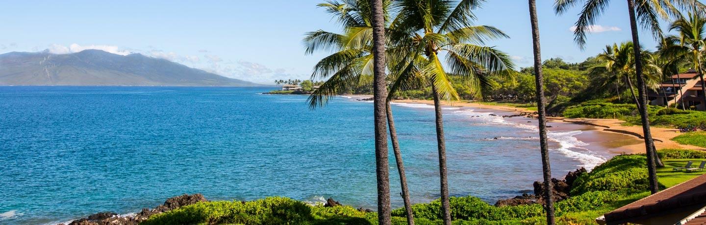 View of Makena Surf property, beach and West Maui Mountains